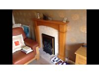 Wooden and marble fire surround and hearth