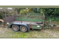 Twin axle trailer. Ramp and mesh sides