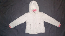 Girls lined jacket for 5 to 6 years. Light beige with wool effect lining. Hooded.