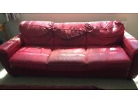 Free Red Leather Sofa - family sofa well used and abused, still usable with throws over them