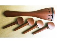 Cello tailpiece and 4 pegs. Hardwood, brown. Never been used. Tailpiece: 240mm Pegs: Length 105mm