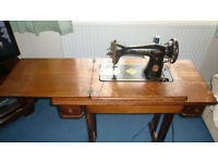 Early Singer electric sewing machine in oak table. One of the very first electric versions.