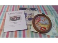 Two new cross stitch charts of dogs and flowers, one embroidery picture of the countryside.