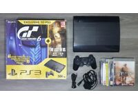Playstation 3 - PS3 - in excellent condition with box 8 games and wireless controller