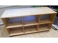 Wooden storage unit on castors