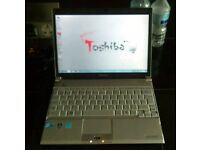 Toshiba ultrabook, webcam, 2gb ram. Windows 7 & office