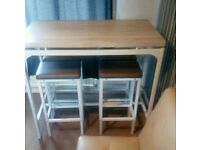 Breakfast bar table and stools was £350 6 months ago