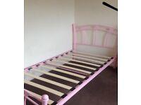 Pink metal heart bed