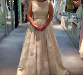 Beautiful ivory wedding dress with good detail! Never been worn. Size 10 - 12