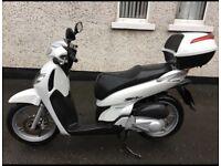 Honda motorbike / scooter / moped (not yamaha vespa kawasaki bmw suzuki)