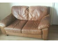Free used two seater leather sofa
