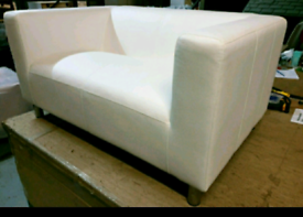 A new stylish white leather effect 2 seated sofa.