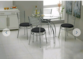 Brand new round glass dining table and chairs