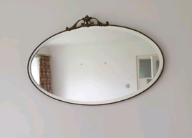 Vintage oval bevelled glass wall mirror in metal frame,