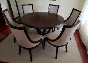 Round dinning table and six chairs