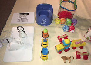 Various baby items - Angelcare monitor, BabyBjorn potty and toys