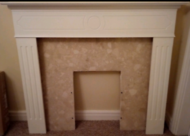Wooden fire surround with marble