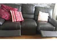 Two and three seater recliners. Brown leather.
