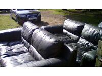 Black leather sofa's