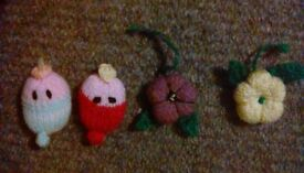 Brooches fun and different knitted flowers or baby faces.
