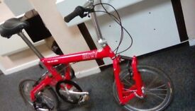 Birdy folding bike in new condition used once unwanted gift really few little marks on frame