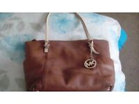 Michael Kors handbag genuine slight wear on bottom but nothing too bad.. Collection only