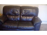 2 X2 Leather Sofas dark blue in good condition, can sell seperately .