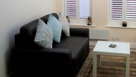 TWO SEATER LEATHER SOFA WITH STORAGE UNDER. CHOCOLATE BROWN. EXCELLENT CONDITION
