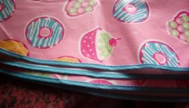 Circular pink cupcake wipe clean tablecloth