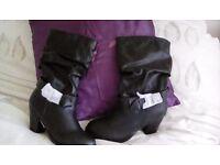 Brand new black heel buckle boots ***