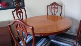 Victorian table plus six chairs of later period