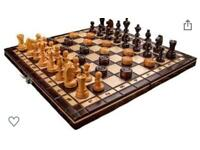 Cherry wood chess & draughty board complete set with pieces stored inside.