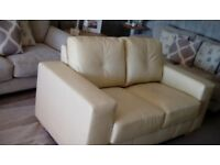 Two seater cream leather sofa
