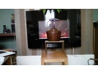 Copper kettle and brass stand