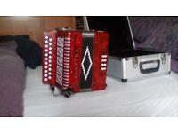 Near new rossini accordion 21 button in alloy case