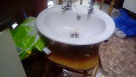 small washroom sink with taps