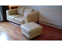 TWO CREAM LEATHER MATCHING SOFAS AND POUFFE