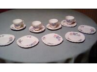 Crown regent china tea cups. lovely clean bright pattern 13 pieces with gold rim. no cracks or chips