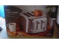 New in box 4 slice toaster
