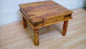 Small wooden table, with metal hinge looking detail. Very different