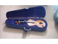 Two violins for sale and stand