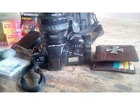 Minolta camera with carry case.