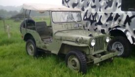 1952 Willys Jeep M38 on the road.
