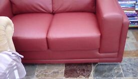 Two two. /three seater leather effect red sofas