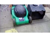 Tesco electric power lawnmower with grass box. Lightweight. Perfect working order