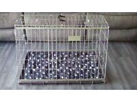Sloping dog or pet cage to fit hatchback / estate car.
