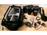 Olympus E-500 camera with 2 lenses