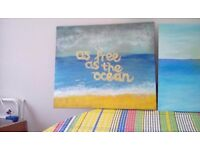 Two hand painted canvas shpowing sea scapes with motivational script