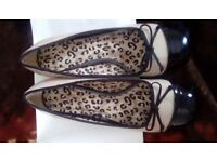 Black and beige patent shoes. Attractive, Contrast colours with black bow detail