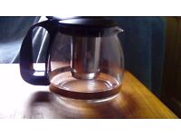 Brand new glass tea pot with strainer